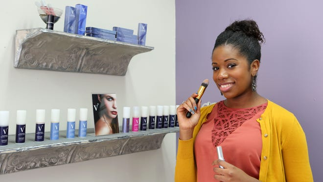 Makeup artist Dionne Bell of Belle Make-up NYC sells an organic line of make-up called Vapour Organic Beauty in her Mamaroneck shop, Dec. 8, 2015.