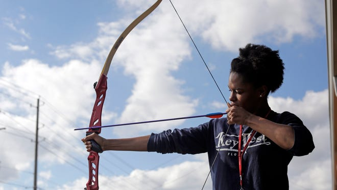 William Carey University sophomore Pashance Lee, 19, practices archery on campus at William Carey University Wednesday, Dec. 9. William Carey is offering scholarships for participation in the university's inaugural archery team, beginning next year.