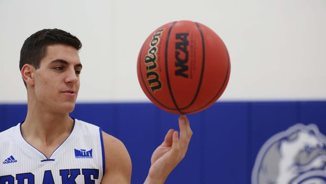 Drake's Reed Timmer spins a basketball on his finger during Drake Men's Basketball media day on Monday, Oct. 5, 2015 at the Knapp Center and Shivers Basketball Practice Facility in Des Moines.