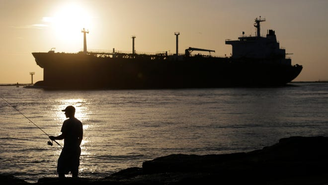 U.S. leaders on Tuesday agreed to end the U.S. oil export ban, in place since the 1970s. The move is likely to stabilize world oil prices, analysts say.