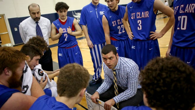 St. Clair coach Shawn Sharrow talks with players in a huddle during a basketball game Friday, Dec. 11, 2015 at Marysville High School.