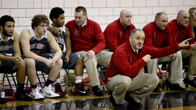Port Huron coach Tony Giancarlo instructs players during the Ed Peltz Holiday Basketball Tournament Friday, Dec. 18, 2015 at Port Huron Northern High School.