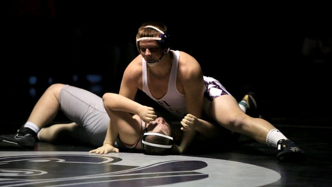 Will Atkins (top) and Mitchell are the defending NCHSAA 1-A champions in dual team and tournament competition.