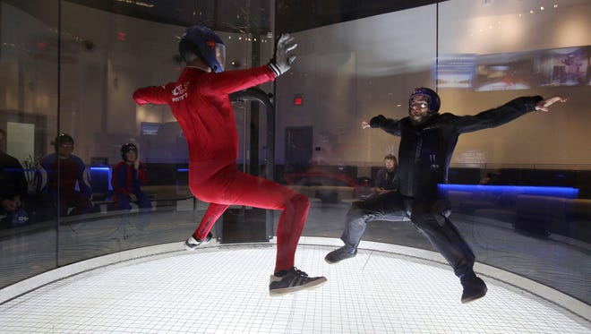 Robert Owen of Skydive Jersey in  Pittstown, NJ, right, is guided by instructor Chris Dixon during a visit to iFly, an indoor skydiving place at Ridge Hill in Yonkers, with his colleagues, Dec. 21, 2015.