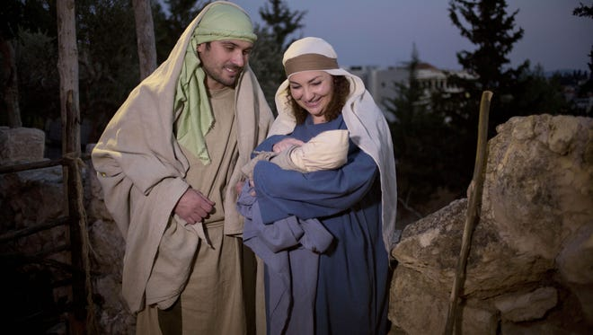 Christians play the parts of Joseph and Mary during a re-enactment of a Nativity scene of the birth of Jesus Christ as part of Christmas festivities at the Nazareth Village in the northern Israeli city of Nazareth, Tuesday, Dec. 22, 2015.