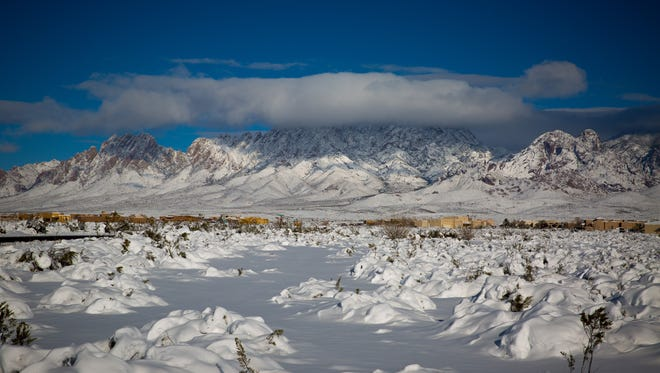 Snow covers the Organ Mountains Sunday, a day after a storm dropped 6 to 12 inches of snow across the Mesilla Valley.