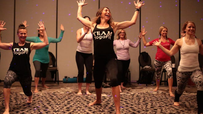 YogaFit founder Beth Shaw, center, works out with a group of instructors at the Rivera Resort and Spa in Palm Springs, on Tuesday, January 5, 2015.