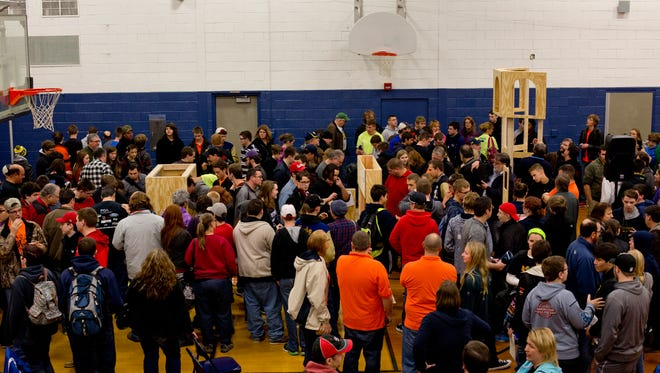Robotics teams take a look over a scale model of the new competition arena during a meeting of area FIRST Robotics teams Saturday, Jan. 9, 2016 at Capac High School.