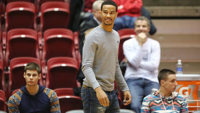 Nick Weiler-Babb, a transfer from Arkansas, watches the Iowa State men's basketball team warm up before their game on Wednesday, Jan. 6, 2016, in Hilton Coliseum. Babb is the younger brother of former Cyclone Chris Babb.
