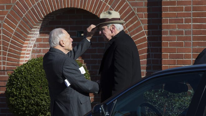 Former U.S. Sen. David Pryor, left, greets another attendant at Dale Bumpers' memorial service at First United Methodist Church in Little Rock, Ark., Sunday, Jan. 10. The Rev. David Freeman led the private service with Pryor and former President Bill Clinton among the speakers. Bumpers died New Year's Day. He was 90.