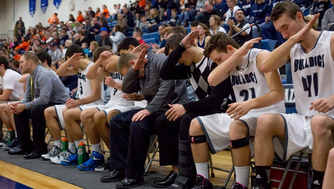"Yale players ""dab"" to celebrate an extra point during a basketball game Friday, Jan. 15, 2016 at Yale High School."