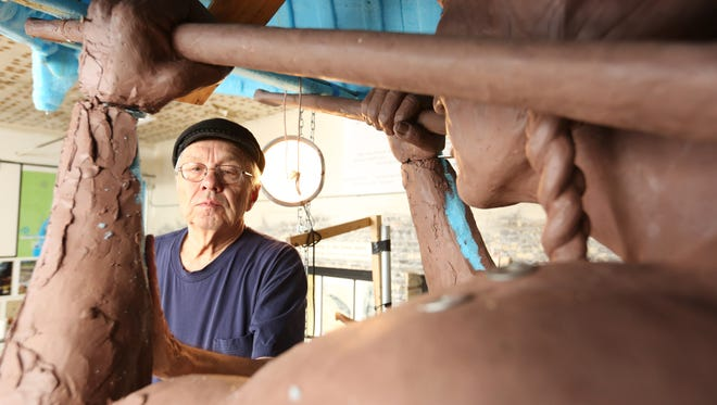Sculptor Skip Wallen works on the Spirit of the Rivers sculpture Jan. 20 at the downtown Manitowoc studio.