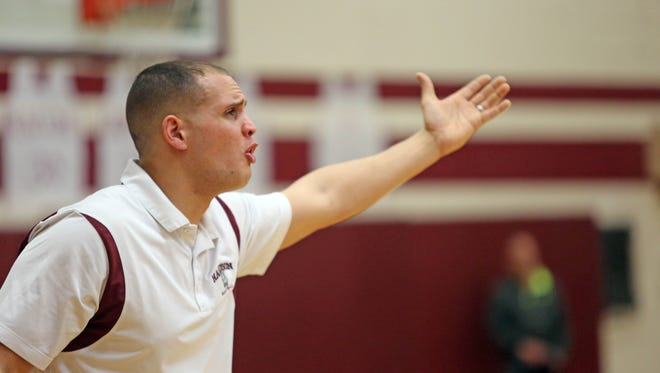 Harrison coach, Louis Kail disagrees with the referee call during game action at Harrison High School on Jan. 20, 2016. Harrison defeated Eastchester 68-63.