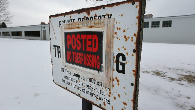 "One of several ""No Trespassing"" signs on the former Paragon property along Seventh Street in Two Rivers, shown here in January 2016."