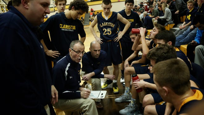 Clarkston coach Dan Fife gives his players instructions during a game against Rochester Adams on Jan. 19.