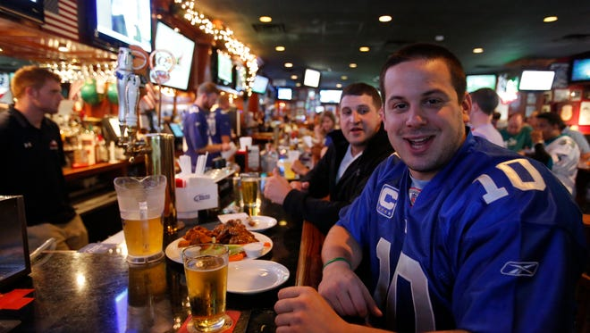 Fans watch the game at Bob Hyland's Sports Page Pub in White Plains.