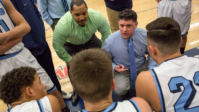 Richmond coach Josh Presnell talks with players in a huddle during a basketball game Friday, Jan. 29, 2016 at Richmond High School.