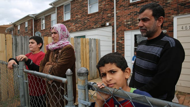 Several members of Ahmad Al Tybawi's family stand outside their Buechel apartment
