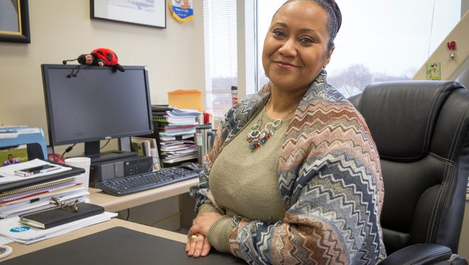 Terry Whitt Bailey, the city of Muncie's Community Development director, works in her office Tuesday afternoon. Bailey was appointed to office by Dennis Tyler in 2012.