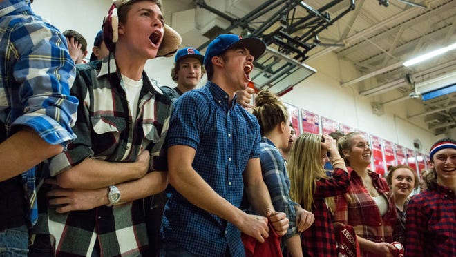 St. Clair students cheer during a basketball game Thursday, Feb. 4, 2016 at St. Clair High School.