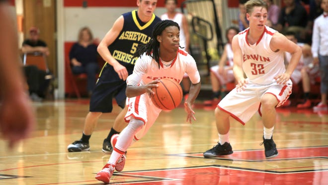 Erwin's C.J. Thompson brings the ball up the floor earlier this season in a nonconference game against Asheville Christian Academy.
