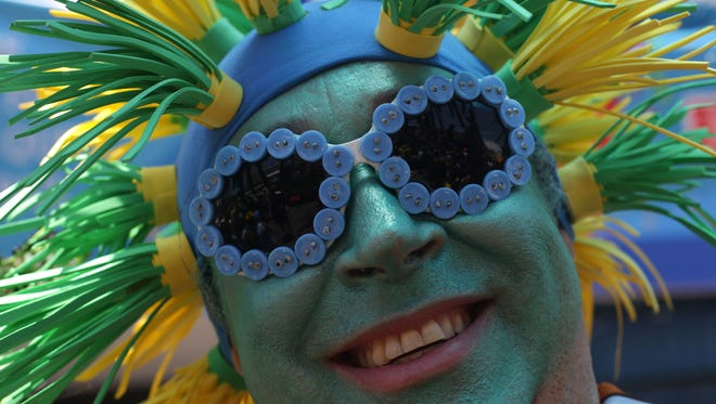 "A reveler takes part in the ""Galo da Madruga"" or The Dawn Rooster carnival parade, in downtown of Recife, Pernambuco state, Brazil, Saturday, Feb. 6, 2016. The ""Galo da Madrugada"" has the Guinnes World Record of attendance for the largest crowd ever in a carnival parade."