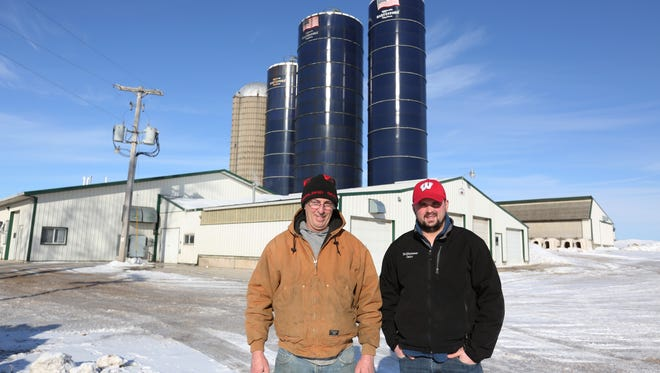 Tom Hochkammer, left, and his son and co-owner, Casey, pose for a portrait on the Hochkammer Dairy Farm Thursday, Feb. 4. The farm, which was established in 1849, has always been kept in the family and Casey Hochkammer, the sixth generation, has been working on the farm since he graduated from high school in 2003.