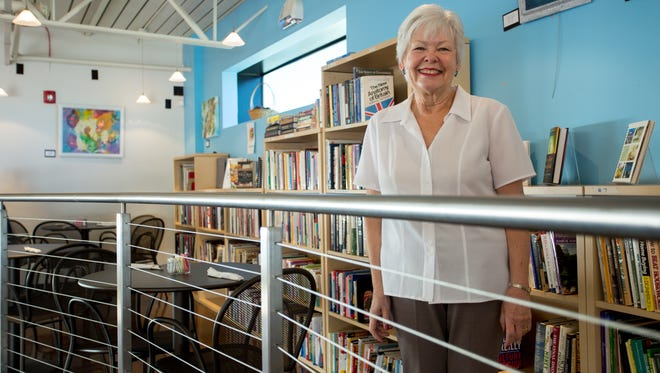 Volunteer Linda Keyes maintains the book collection at Birt's Bistro, the restaurant and bookstore for elder-care nonprofit Benevilla, in Surprise Ariz. on Wednesday, Feb. 3, 2016.