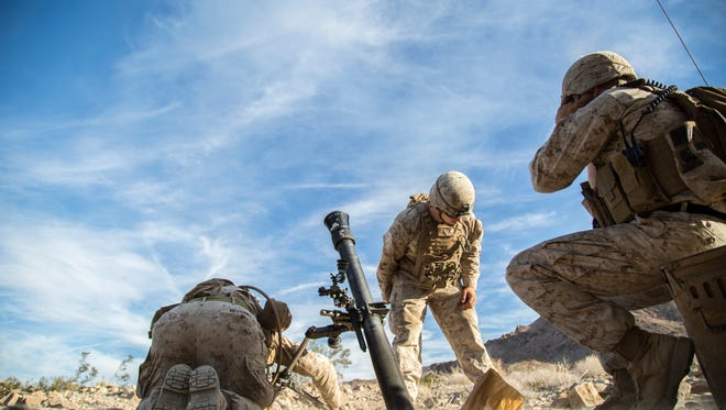 This is what U.S. Marines at Joint Base McGuire-Dix-Lakehurst will be doing on Sunday. As seen here, Marines fire an 81 mm mortar during training at Marine Corps Air Ground Combat Center Twentynine Palms in California on Sept. 2, 2015.