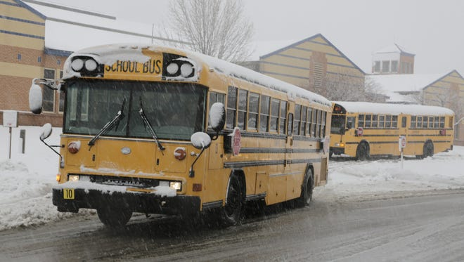 A school bus full of students departs two hours early Wednesday from Vinton Elementary School. Lafayette School Corp. dismissed classes early after heavy snow hit the city Wednesday morning.