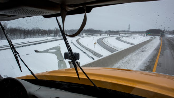 St. Clair County Road Commission plow driver Brennan Burch clears snow Thursday, Feb. 25, 2016 along Interstate-69 near Port Huron.