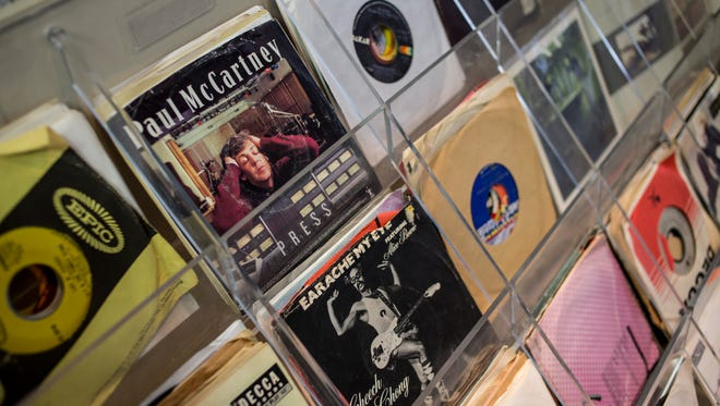 A shelf holds a variety of 45s at LOUD Music and Apparel, 414 Huron Avenue in downtown Port Huron. The store will have a soft opening on April 1, with a grand-opening to coincide with Record Store Day on April 16.