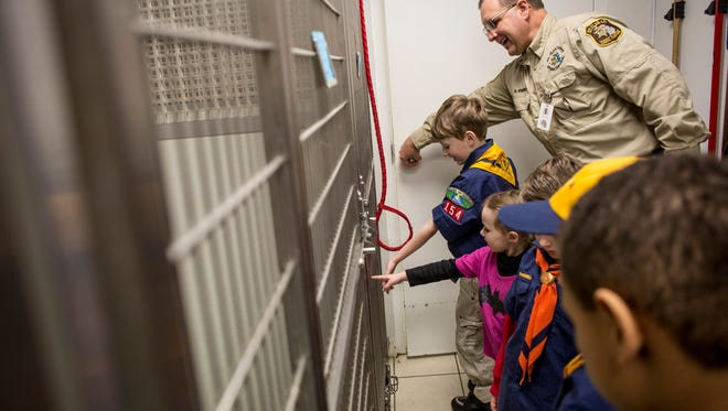 Animal Control officer Scott Foerster gives cub scouts from Indian Woods Pack 154 a tour of the facility Tuesday, March 1, 2016 at St. Clair County Animal Control. The pack donated more than 100 items to the shelter.