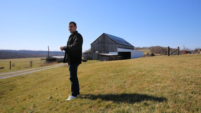 Ahmed Al Tybawi checks out farmland near Taylorsville, Ky.