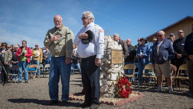 Robert Bouilly, left, historian at the El Paso Sergeants Major Academy and Dick Dean, great grandson of Pancho Villa Columbus Raid victim James T. Dean, share a moment of silence outside the Columbus Railroad Depot Museum with a crowd gathered to commemorate the 100th anniversary of the raid March 9, 2016.