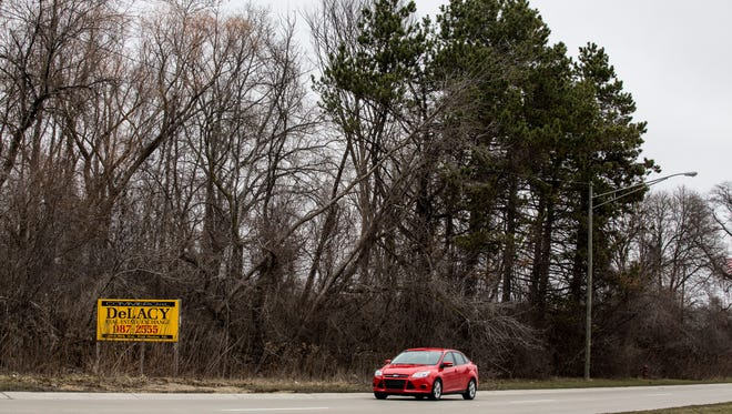 A vehicle passes by a vacant lot Tuesday, March 15, 2016 along Gratiot Avenue in Marysville. The city has created a new industrial development district bordered by Gratiot Avenue, Ravenswood Road, and train tracks to the west.
