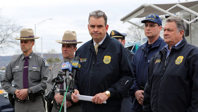 George Longworth, Public Saftey Commissioner, briefs the media that the third victim from Saturday's tugboat crash will not be recovered until the vessel is salvaged from the water, March 15, 2016 in Tarrytown.