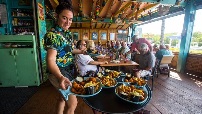 Staci Misner, a server, works at Parrot Key Caribbean Grill on Fort Myers Beach.