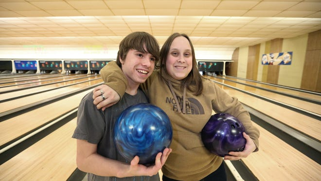 Big Sister Becky Wilhelm, and her Little Brother, Cole, pose for a photo after bowling at Meadow Lanes North on Tuesday, March 15. Wilhelm and Cole were matched seven years ago when Cole was 7 years old.