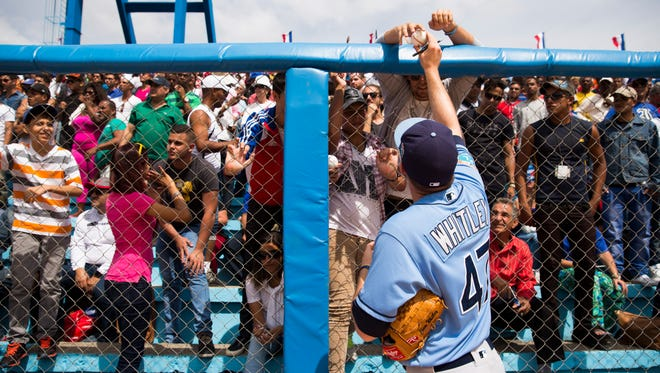 Tampa Bay Rays relief pitcher Chase Whitley (47) signs autographs for fans before a baseball game between the Rays and the Cuban national team in Havana, Cuba, Tuesday, March 22, 2016. It's the first game featuring an MLB team in Cuba since the Baltimore Orioles played in the country in 1999.  (Will Vragovic/The Tampa Bay Times via AP)  TAMPA OUT; CITRUS COUNTY OUT; PORT CHARLOTTE OUT; BROOKSVILLE HERNANDO TODAY OUT; MANDATORY CREDIT