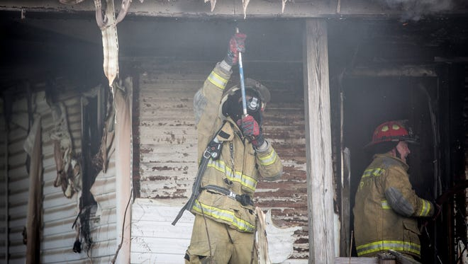 Fire crews from multiple districts help to battle a large house fire Sunday afternoon at 9901 E. Washington St. in Selma. One person, home at the time of the fire, was taken to IU Health Ball Memorial Hospital for burns and other injuries from the fire.