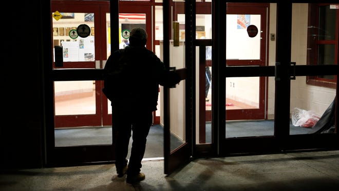 A man enters the Northern Westchester Boys and Girls Club center before heading for the winter shelter at the United Methodist Church in Mount Kisco on March 30.