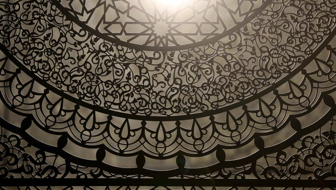"Pakistani born Artist and Herron School of Art and Design Professor Anila Quayyum Agha's piece titled ""Intersections,"" is on public display in the Indiana State Museum Contemporary gallery, Thursday March 24th, 2016. Agha was the first to win both the juried and popular grand prizes at the 2014 ArtPrize, the world's largest art festival."