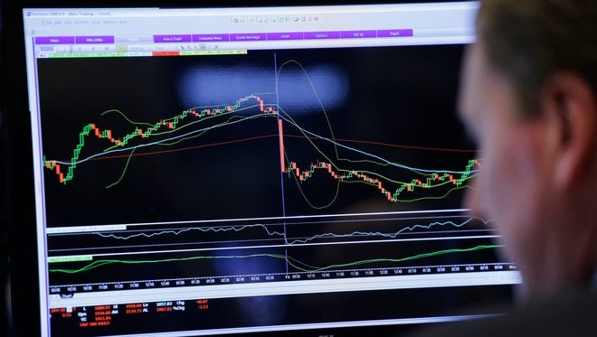 In this Friday, Jan. 15, 2016, file photo, a trader monitors stock prices at the New York Stock Exchange.  (AP Photo/Mark Lennihan, File)