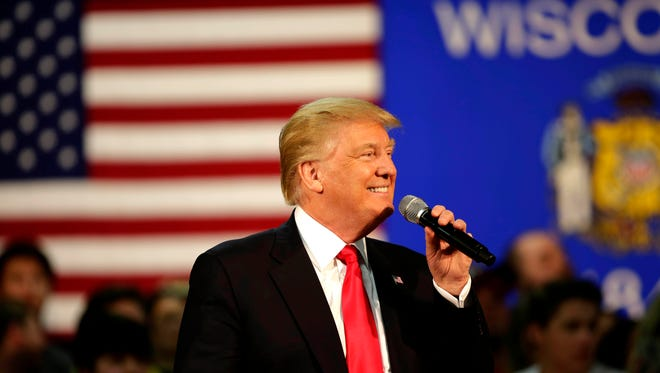 Presidential hopeful Donald Trump smiles while speaking at a campaign town hall event in Rothschild on April 2.