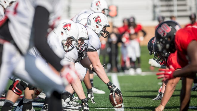 Ball State's football team runs drills during spring training. The teams first game of the regular season is on September 10 in Bloomington.