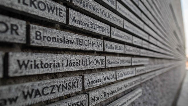 A wall commemorates Poles who saved Jews by hiding them from the Nazis during the Holocaust.
