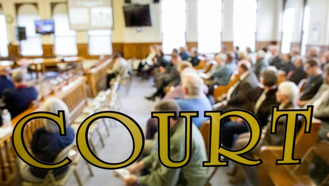 Dozens of people listen to a historic presentation as part of the 100th anniversary celebration Tuesday, April 12, 2016 at the Sanilac County Courthouse in Sandusky.