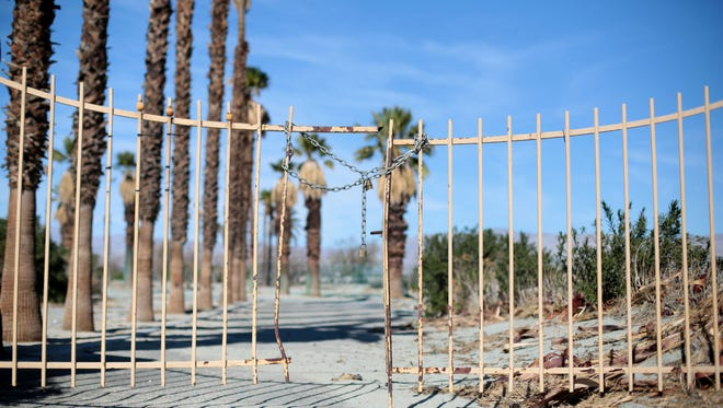 The Verona Road entrance to the closed Whitewater Country Club in Palm Springs. The withered golf course, also known as the Palm Springs Country Club, has been vacant for about a decade.