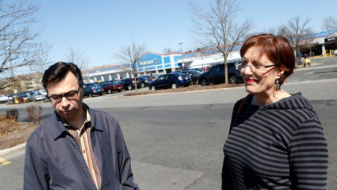Kevin Czerwinski of Suffern and Karen Daniels of Airmont react to the federal arrest of Ramapo supervisor Christopher St. Lawrence on charges tied to the financing of the town's baseball stadium through its economic development agency, April 14, 2016 in Airmont.